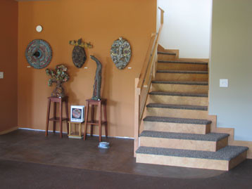 Radiant floor heat in an earthen floor (foreground) and stained concrete (background).  Barefoot Radiant Heating.