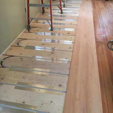 New flooring going in over sleeper system in small addition. Barefoot Radiant Heating.