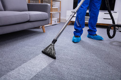 Low Section Of A Male Janitor Cleaning C