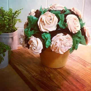 A cupcake flower pot