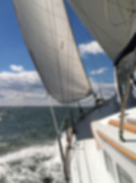 Surprise under sail with spray.jpg