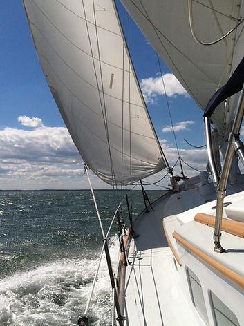 Surprise under sail with spray.jpg