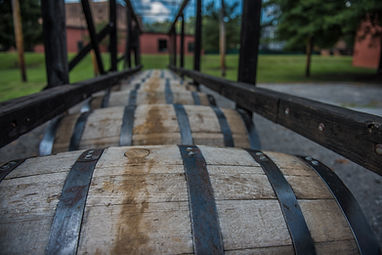 Bourbon barrels at a distillery along th