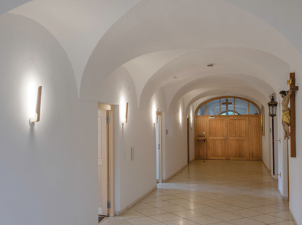 Monastery hallway with our swan wall lights