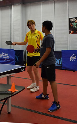 Coach is having discussion on forehand drive technic with student