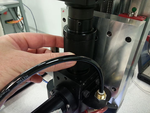 Fiber optic laser collimator on servo axis, industrial automation in Dallas Texas