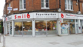 Shop window of asian supermarket Thai Smile