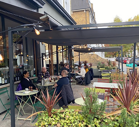 A photo of the outside seating at the front of the bar