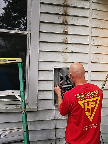 Josh, one of the Hoco Power workers working on an electrical panel at a house in Houston County.