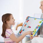 girl-learning-alphabet-with-tutor-PQLK6D