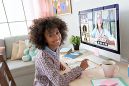 african-kid-girl-looking-at-camera-during-online-c-2HMHTDV.jpg