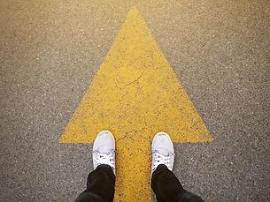 Feet and arrows on road.jpg