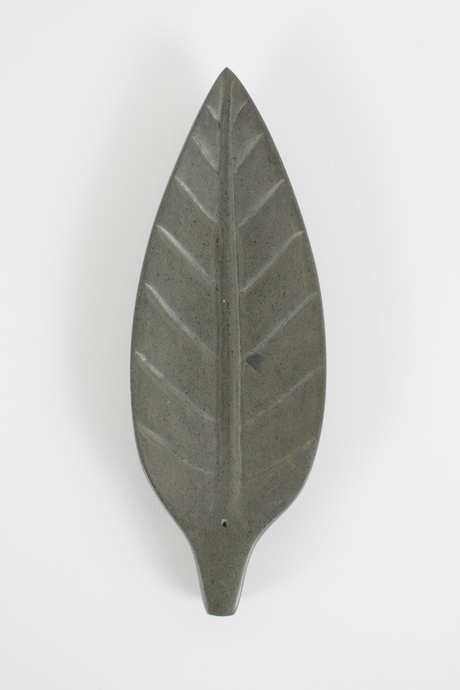 Leaf shaped, handcrafted in Haiti using gray river stone.