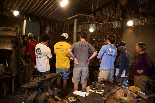 Youth gathered for a blacksmith workshop