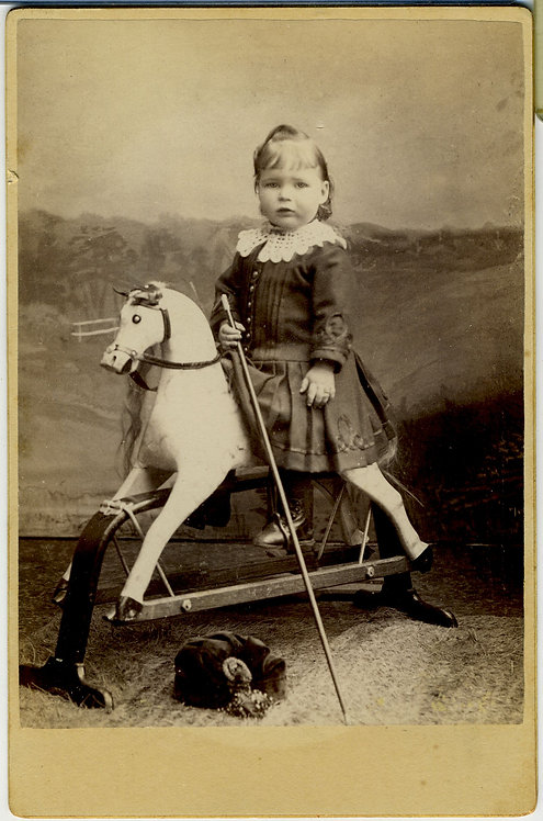 CABINET CARD - YOUNG GIRL POSING ON HOBBY HORSE.