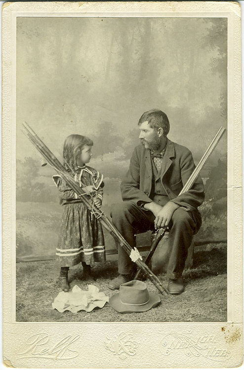 MAN WITH YOUNG CHILD - RIFLE - FISHING POLES