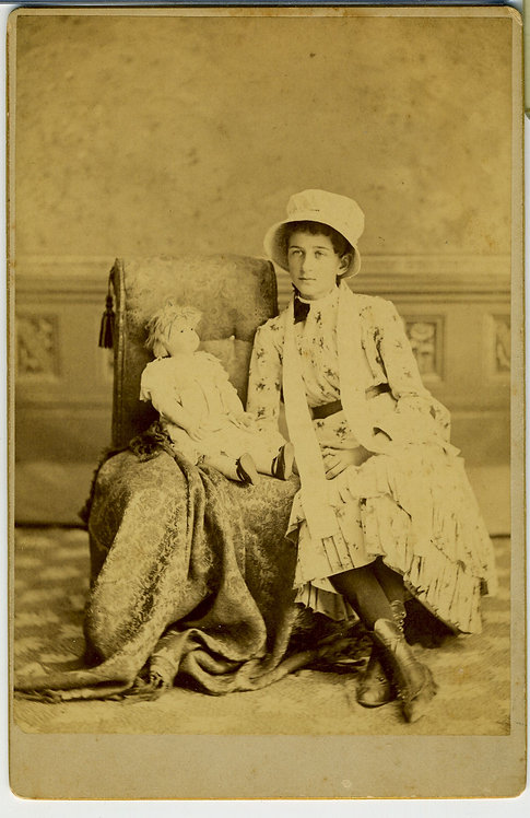 CABINET CARD - YOUNG GIRL SEATED  WITH LARGE DOLL.