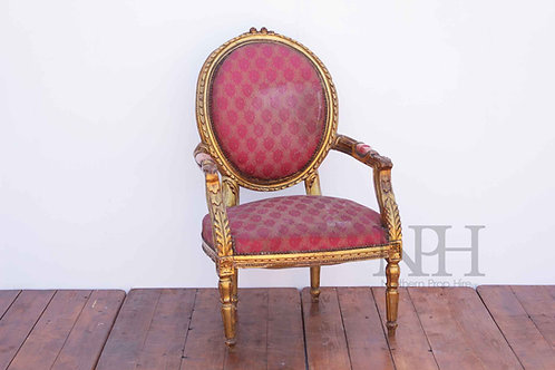 Red upholstered gold throne