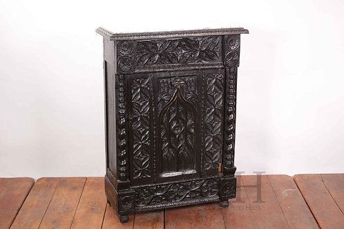 Carved marble toped cabinet