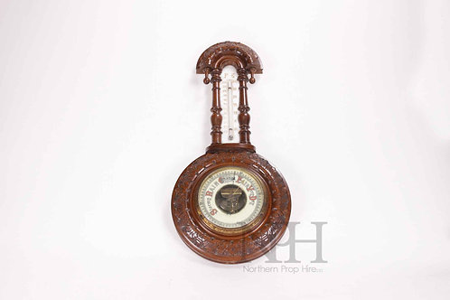Small carved Barometer