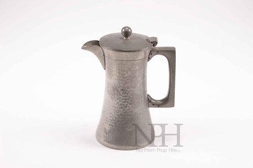 Hammered pewter jug