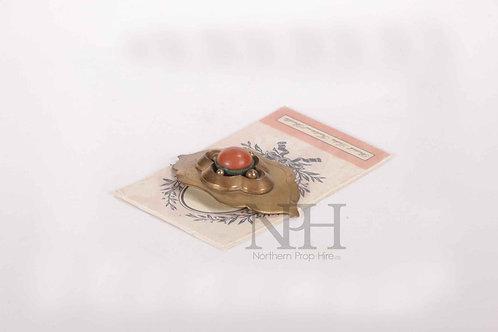 Brooch on card