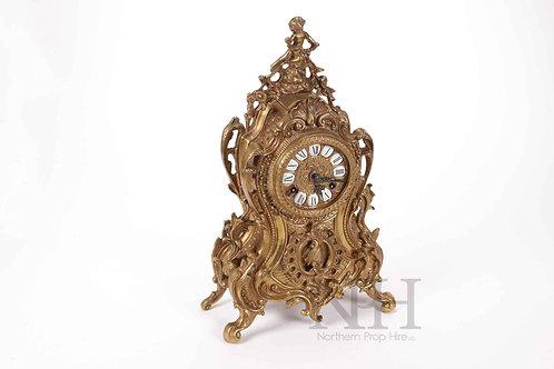 Cast metal clock