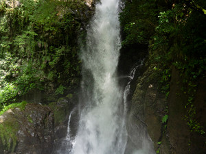 Misty waterfalls and sacred boulders