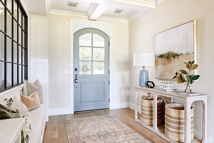 Spacious entryway design with console table and built-in seating