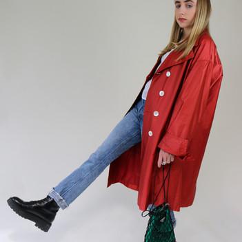 Model wears vintage Cerruti 1881 jacket, vintage Fendi top, Helmut Lang jeans, Prada bag, & Other Stories boots.