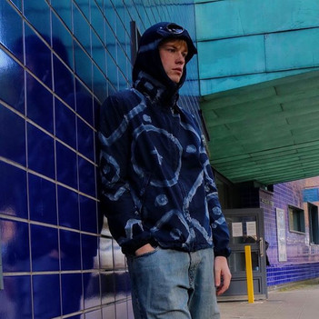 Model Ben wears rare dyed Stone Island Cashmere hooded jumper, styled with 86/500 pieces CP company jacket, and Dolce and Gabbana denim jeans. Clothes provided by PastDown vintage and Type2 Archive.