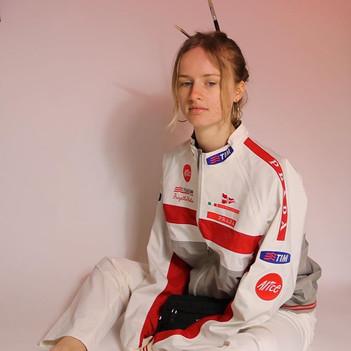 Model Katherine wearing Prada 2005 Luna ROSSA Sporting Jacket, 2003 Prada Nylon Pants, 2017 Prada Nylon Belt Bag