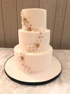 White and Gold Flower Wedding Cake