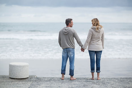 couple-standing-with-holding-hands-on-th