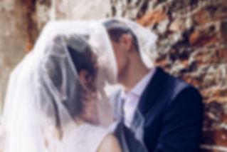 Groom kissing bride Nottingham