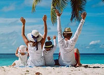 happy-family-with-two-kids-hands-up-on-t