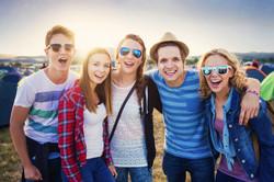 Group of beautiful teens at summer festival. Young teens at summer music festival. Funny group of yo