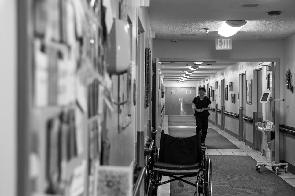 """Kremer checks on patients at the Greenwood Nursing and Rehabilitation Center before her shift ends. """"Some days I love what I do but some days it's hard to just see these people in this situation. Some of them will make it through their therapy and recover just fine but then some of them get transferred into our long-term care facility. Now that's hard to see,"""" Kremer said."""
