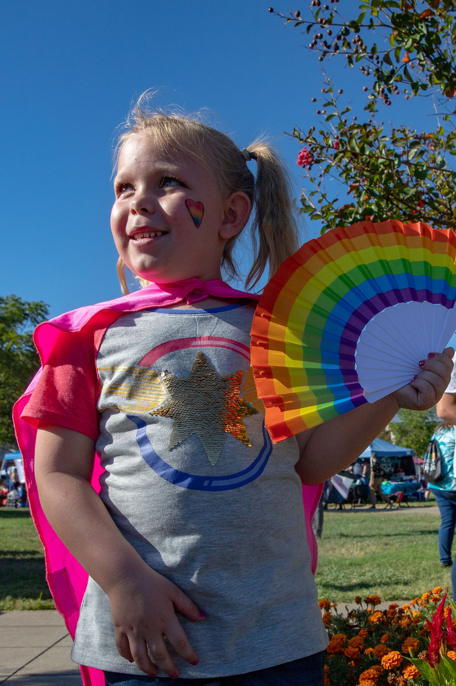 """Peyton Church, a 5-year-old Bowling Green native, celebrates at the Bowling Green Pride Festival. Church attended the festival with her mother and sister in order to show support for her sister, Sydney, who identifies as a member of the LGBTQ+ community. """"I got to get my nails and face painted today and celebrate with my mom and sister, so I think it's been a fun day. I love getting to have fun and just celebrate my sister and see her so happy,"""" Church said."""