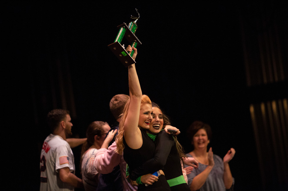 Nicole Childress (left) and Becca Buckner (right) of Western Kentucky University's Alpha Delta Pi sorority celebrate their victory during Kappa Delta's Shenanigans event on Tuesday, Oct. 9th, 2018 at the Southern Kentucky Performing Arts Center in downtown Bowling Green, Kentucky.