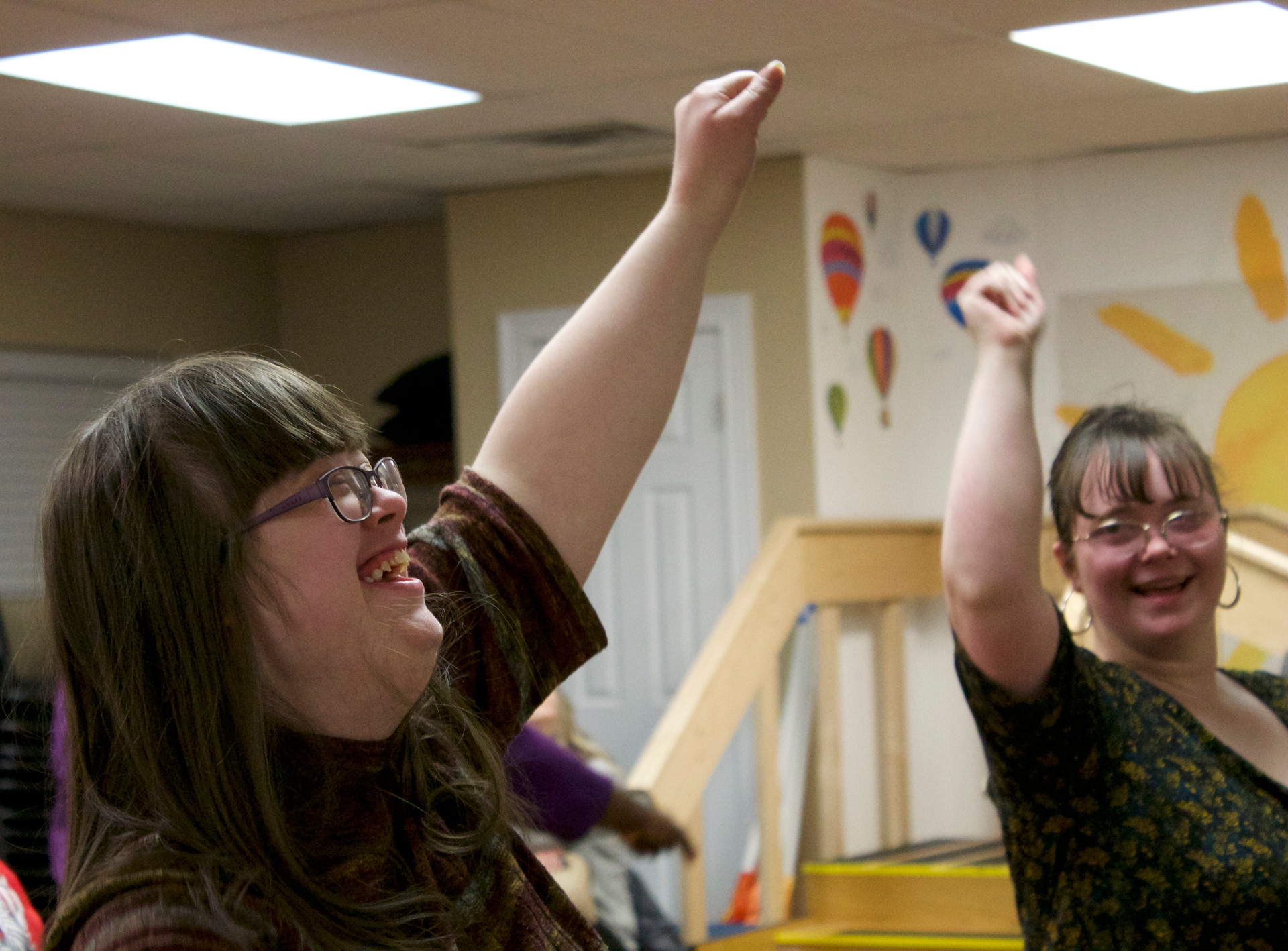 "Katie Green (left) and Lucy  McCormick (right) practice their cheer routine with the Roar Cheerleading Squad at The Buddy House in Bowling Green, Kentucky on Feb. 6, 2018. The Buddy House is a nonprofit organization that organizes activities to encourage equality for locals with Down syndrome.""I really like to cheer now,"" Katie said, ""My favorite part about it is getting to see all of my friends every week."""