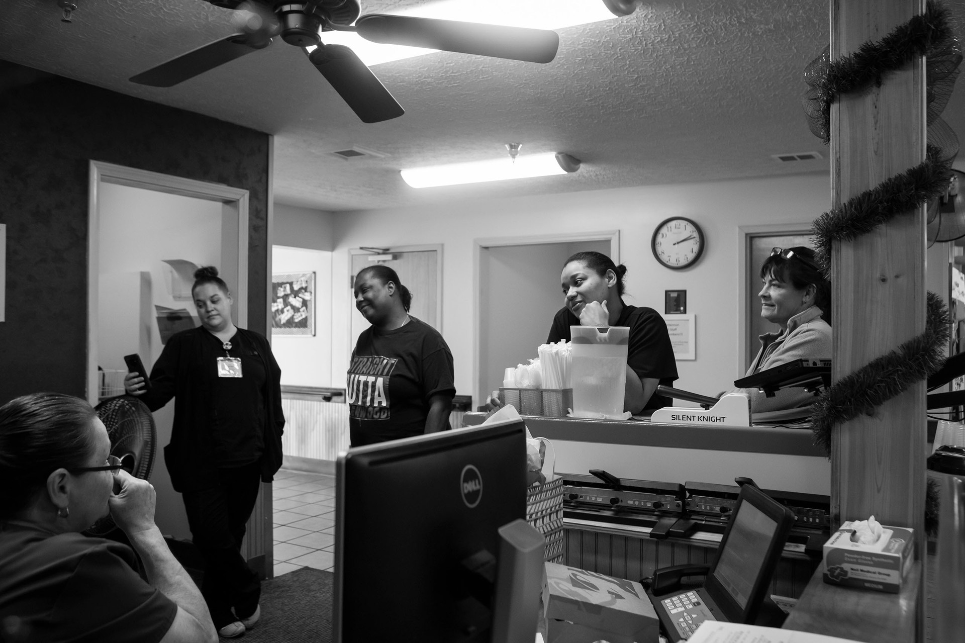 Kremer chats with her coworkers about their annual Christmas party and gift exchange before clocking out of her shift at work.