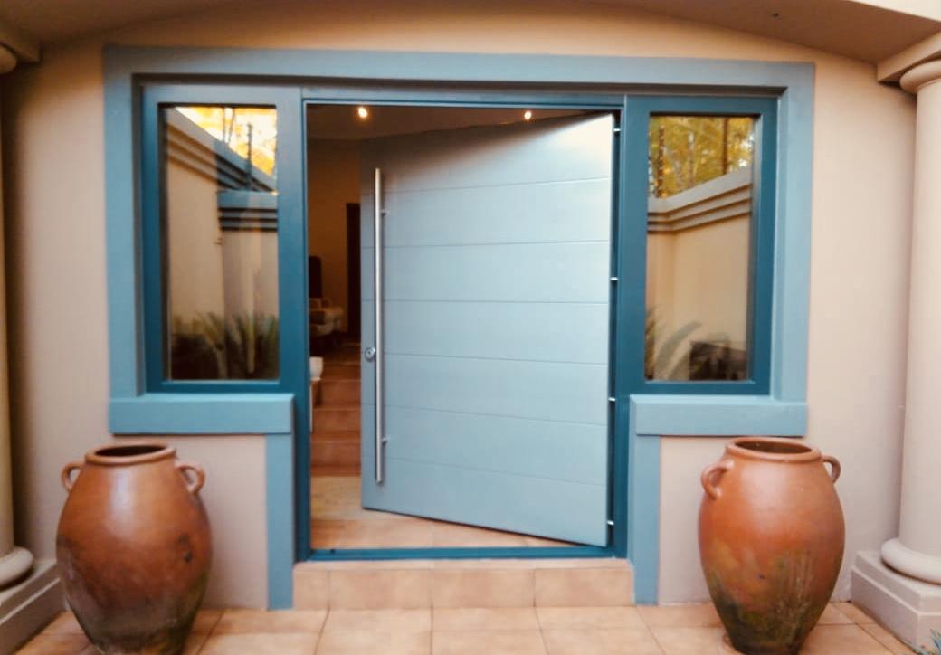 Door with bullet proof glazing