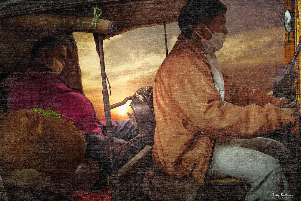 Rickshaw and sleeping passenger.