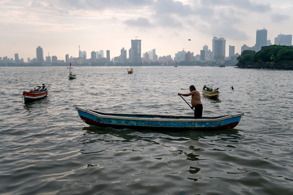 Koli fisherman rowing out to fish, Mumbai