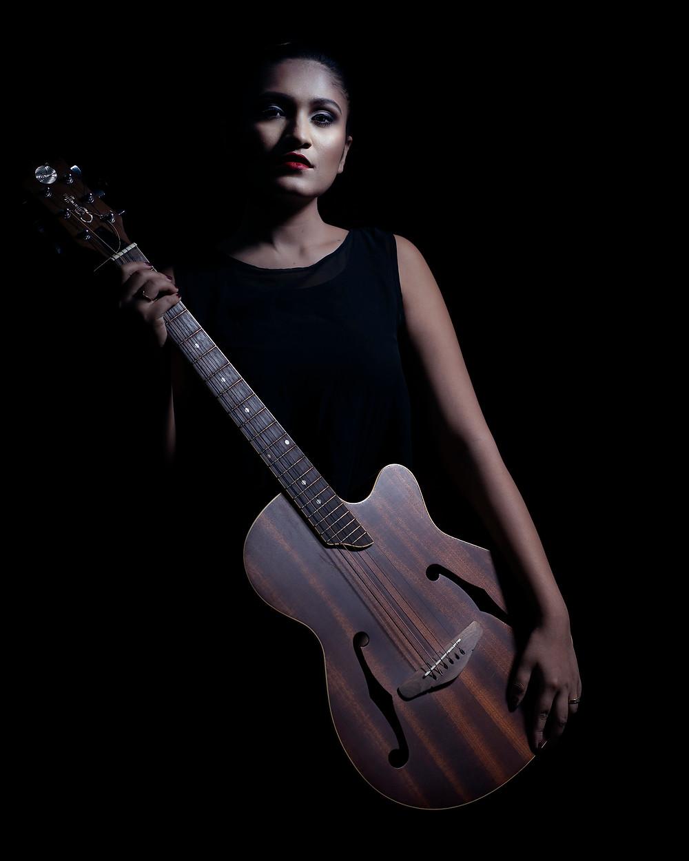 Model posing with guitar