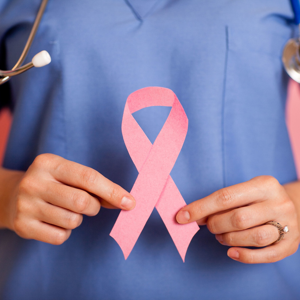 doctor holding breast cancer ribbon