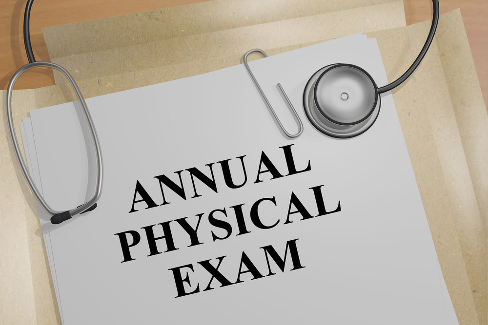 white paper list with text Annual Physical exam and stethoscope