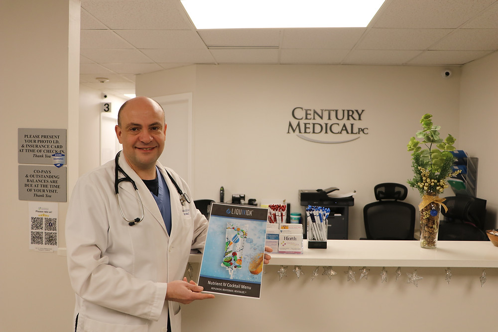 doctor in white coat holding a paper about nutrient IV cocktail menu