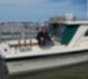 John on Boat cropped.jpg